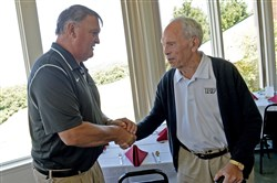 Chuck Klausing, right, greets legendary former Woodland Hills coach George Novak at a luncheon in 2015.