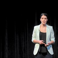 Emily Kennedy of Marinus Analytics presents her company at the UpPrize competition held in the New Hazlett Theater on the North Side in July.