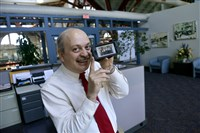 John D'Angelo, AAA East Central vice president of human resources, proudly shows off a photograph of his staff.