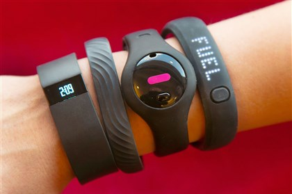 Four fitness trackers, from left, Fitbit Force, Jawbone Up, Fitbug Orb, and the Nike FuelBand SE.