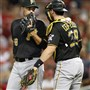 Joakim Soria #38 and Francisco Cervelli #29 of the Pittsburgh Pirates talk in the seventh inning against the Cincinnati Reds at Great American Ball Park on July 31, 2015 in Cincinnati, Ohio. The Pirates defeated the Reds 5-4.