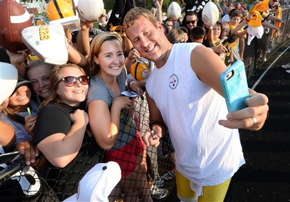 Steelers quarterback Ben Roethlisberger takes a selfie with one of the thousands fans at the Steelers evening practice at Latrobe Memorial Stadium in Latrobe.
