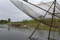 Participants paddle a country boat during a traditional boat race at Dashiachora, in Kurigram enclaves, Bangladesh. Bangladesh and India are going to officially exchange the adversely possessed enclaves Friday midnight where the two neighboring countries will implement the Land Boundary Agreement in line with a deal signed in 1974. (AP Photo)