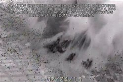 This image made from gun-camera video taken on July 4, 2015 and released by United States Central Command shows an airstrike on a bridge near Islamic State group-held Raqqa, Syria, that was a key transit route for the militants. After billions of dollars spent and more than 10,000 extremist fighters killed, the Islamic State group is fundamentally no weaker than it was when the U.S.-led bombing campaign began a year ago, American intelligence  agencies have concluded. (U.S. Central Command via AP)