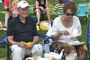 Don Doyle, left, of Oakmont and his friend Lynne Bryan, also from Oakmont, join their friends in a little picnic in Highland Park before the start of the first performance in the Reservoir of Jazz series.