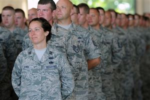 Capt. Valerie Lewis and others look on during the command ceremony for Col. Gregg Perez. Colonel Perez assumed command of the 171st Air Refueling Wing in Findlay.
