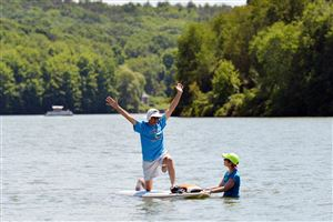 Fred Parker, 68, of Monroeville, practices yoga on stand-up paddle boards under the instruction of Natalie Roberson on Lake Arthur in Moraine State Park. The yoga, called supyoga, is one of the activities offered during The Regatta at Lake Arthur.