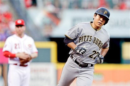 Pirates shortstop Jung Ho Kang rounds the bases after hitting a solo home run against the Reds in the fourth inning Saturday in Cincinnati.