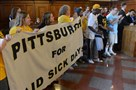 Members of the United Food and Commercial Workers show their support after Pittsburgh City Council voted to approve a paid sick leave ordinance.