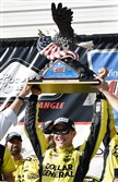 Matt Kenseth celebrates after winning the Pocono 400 Sunday in Long Pond, Pa.