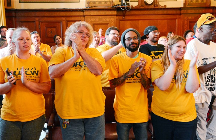 20150803ng-Sick1 Members of the United Food and Commercial Workers cheer after Pittsburgh City Council members voted to approve a the ordinance.