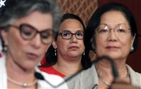 Ane Marie Benitez, center, director of Government Relations for the National Latina Institute for Reproductive Health, watches as Sen. Barbara Boxer, D-Calif., left, and Sen. Mazie Hirono, D-Hawaii, right, address reporters in defense of Planned Parenthood on Monday on Capitol Hill in Washington.