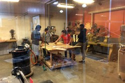 Students in the summer's first 412 Build session learn woodworking skills at TechShop.