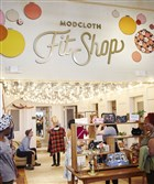 "Inside the San Francisco-based ModCloth Fit Shop, the brand's first extended brick and mortar shop where customers can try on pieces with help of ModCloth stylists before ordering them from ModCloth.com. Pop-up shops on the ""ModCloth IRL (in real life) Tour"" will be modeled after the fit shop in San Francisco."