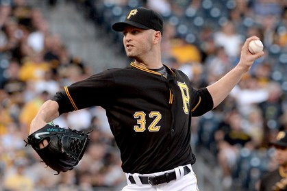 J.A. Happ throws out his first pitch as a Pirate as his team takes on the Cubs on Tuesday at PNC Park.