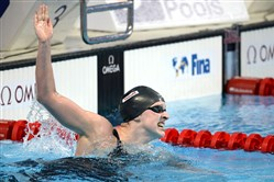 Katie Ledecky celebrates after setting a world record in the final of the women's 1,500-meter freestyle Tuesday in Kazan, Russia.