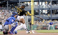 Pirates' Andrew McCutchen hits a home run against the Cubs in the third inning when the teams played against each other on Aug. 5 at PNC Park. The rainout game from Aug. 3 will be made up for with a doubleheader on Sept. 15.