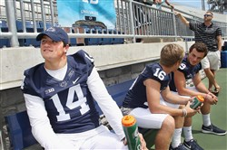 Penn State quarterback Christian Hackenberg (14) talks to reporters as backup quarterbacks Billy Fessler (16) and Trace McSorley (9) sit idly by during Media Day on Aug. 6, 2015 at Beaver Stadium.