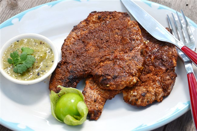 Grilled Chili-Rubbed Pork Chops with Grill-Roasted Tomatillo Salsa.