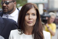 Pennsylvania Attorney General Kathleen Kane arrives to be processed and arraigned Saturday at the Montgomery County detective bureau in Norristown, Pa.