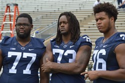 Penn State offensive linemen Chasz Wright, Paris Palmer and Sterling Jenkins wait for the offensive line's group photo in Beaver Stadium during media day earlier this month.