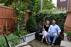 Kitty Vagley and Jeff Neubauer in the back yard garden/patio of their South Side home that will be on the South Side garden tour.