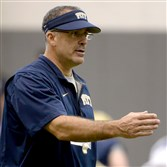 Pitt head coach Pat Narduzzi talks with players during training camp Tuesday on the South Side.