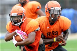Clairton RB Lamont Wade, left, and QB Aaron Mathews, right, at a practice earlier this month.