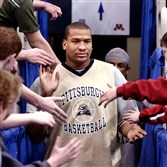 Pitt's Ontario Lett shakes hands with fans as he enters the Metrodome for a practice in preparation for his team's game against Marquette in the NCAA Midwest Regionals in Minneapolis in March 2003.