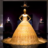 "A glittering gold evening gown by Chinese designer Guo Pei is part of the exhibition ""China: Through the Looking Glass."""