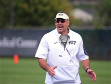 Pitt football coach Pat Narduzzi fires up his players during morning practice yesterday.
