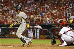Pirates center fielder Andrew McCutchen hits a one run triple off of St. Louis Cardinals starting pitcher Michael Wacha during the fifth inning at Busch Stadium on Aug 12, 2015.
