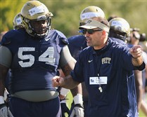 Defensive lineman Tyrique Jarrett (54) looks on as coach Pat Narduzzi get the line set for the next drill earlier this month.