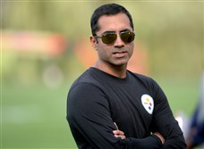 Steelers director of analytics Karim Kassam watches from the sidelines at training camp Wednesday evening at Saint Vincent College in Latrobe.