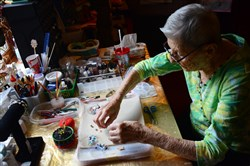"Martha Montesano, 93, of Robinson makes ""angel bracelets"" for breast cancer patients at her home. She was inspired when her daughter, Barbara Rudison, was undergoing chemotherapy."