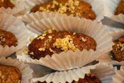 Finikia cookies  are flavored with cinnamon, dipped in warm honey syrup and topped with walnuts.