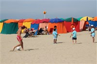 Deauville's signature brightly colored umbrella tents along the town's expansive shoreline.