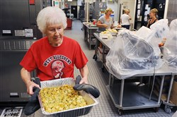 Laverne Palko, mother of coach Bob Palko, prepares lunch for the football players after morning practice at West Allegheny High School.