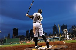 Gene Collier laments that it's only 22 weeks until baseball games of consequence are played again. Here, Pirates' CF Andrew McCutchen warms up for his at-bat in the fourth inning against the Tigers Wednesday at PNC Park. All players wore number 42 in honor of Jackie Robinson day, April 15, 2015