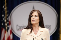 Pennsylvania Attorney General Kathleen Kane speaks during a news conference on Aug. 12 in Harrisburg in which she said charges against her were part of a conspiracy to cover up a chain of pornographic and bigoted emails passed among judges, prosecutors and lawyers.