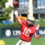 Pitt's quarterback Chad Voytik throws a pass during drills Wednesday morning at the team's South Side practice facility.