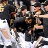 Teammates mob Pirates' Pedro Florimon after he hit a walk-off single in the 15th inning against the Diamondbacks last month  at PNC Park.
