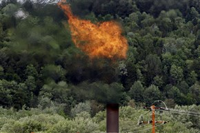 Methane gas burns off a stack near the Washington Electric Cooperative power plant in Coventry, Vt. The Obama administration is proposing to cut methane emissions from U.S. oil and gas production by nearly half over the next decade in an unprecedented step to curb climate change.