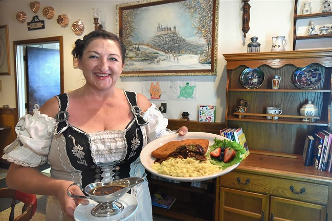 Eva Hough has opened Eva's German Kitchen on Spring Street in Latrobe featuring German selections such as this Jager Schnitzel with Spatzle and dark mushroom gravy. The restaurant is decorated with paintings done by her father, such as this one of the Castle Holenzollern.