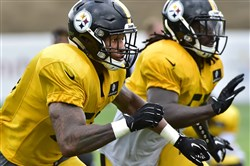 Steelers linebackers Ryan Shazier, left, and Sean Spence during Thursday afternoon practice at St. Vincent College in Latrobe.