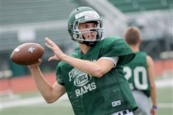 Quarterback Phil Jurkovec throws a pass during a Pine-Richland football practice on Aug. 18, 2015.