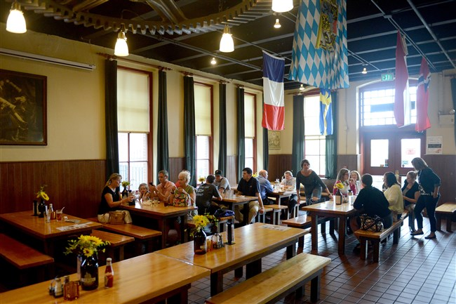 Patrons eat and drink at Penn Brewery in Troy Hill.