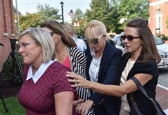 Former Baltimore Ravens cheerleader  Molly Shattuck, second from right, arrives at the Sussex County Courthouse in Georgetown, Del., for sentencing, today.