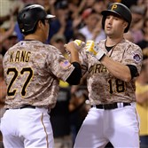 Jung Ho Kang congratulates Neil Walker on his two-run home run in the sixth inning Thursday against the Giants at PNC Park.