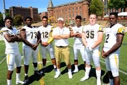 Central Catholic High School football team defensive coordinator Dave Fleming with players from left, Bricen Garner, C.J. Thorpe, Rashad Wheeler, Damar Hamlin, David Adams, and Ron George.